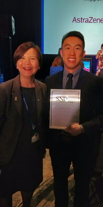 Bryan winning an award at SNO 2019