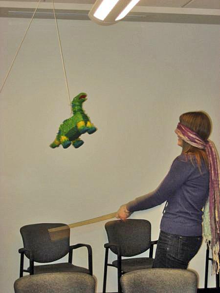 Ashley taking a few swings at the dinosaur pinata