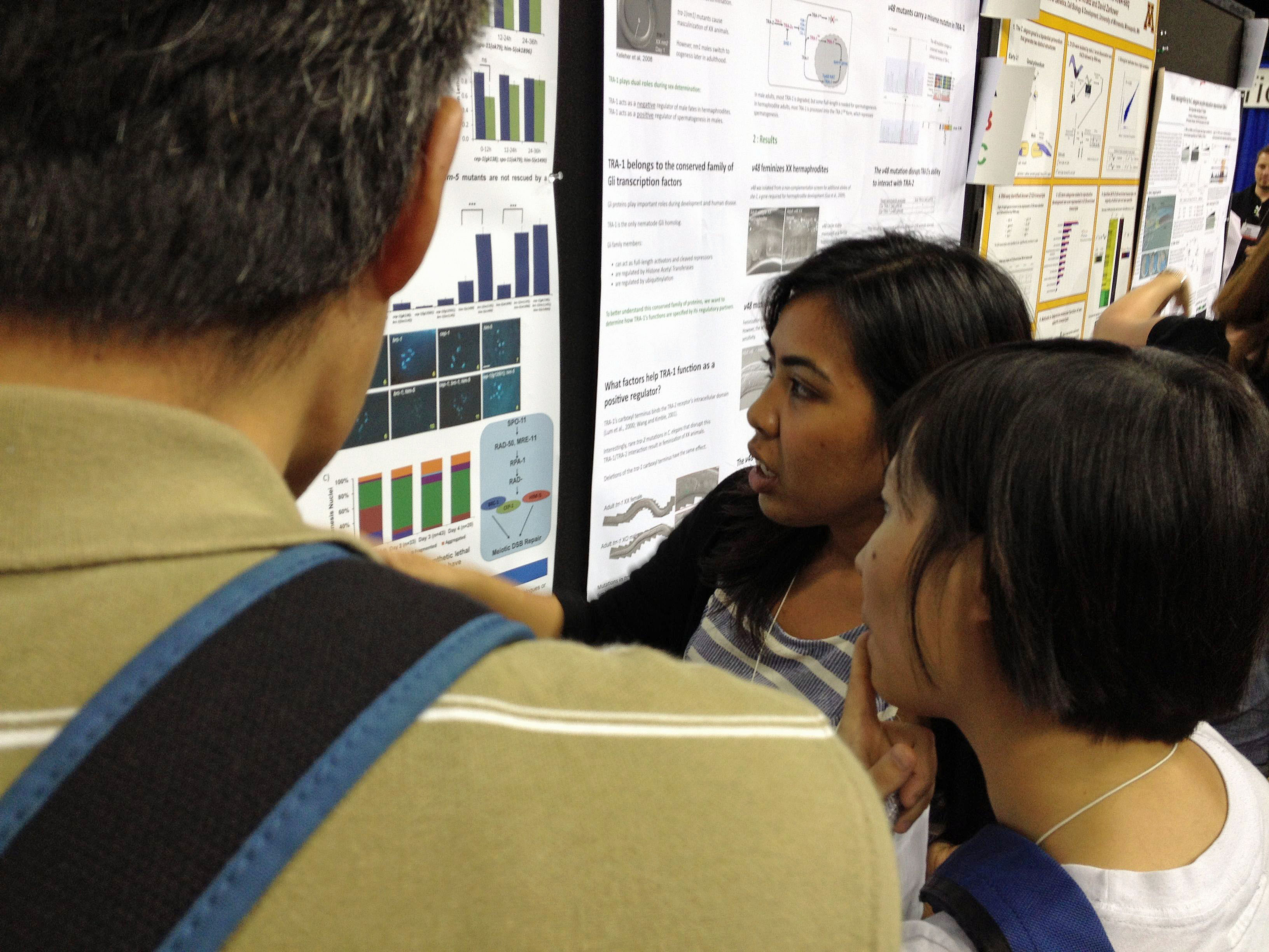 Abigail presenting her poster at the Worm Meeting
