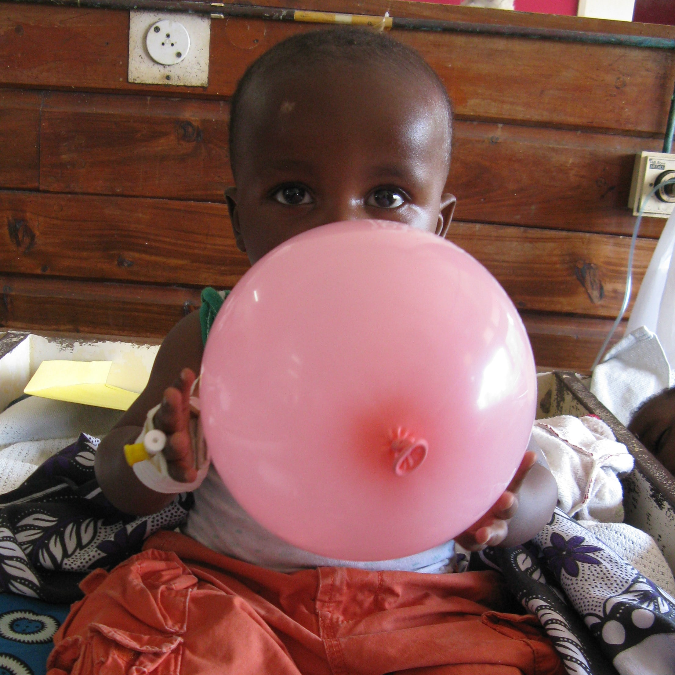 Photo of child in Kenya playing with balloon, taken by Helen Dimaras