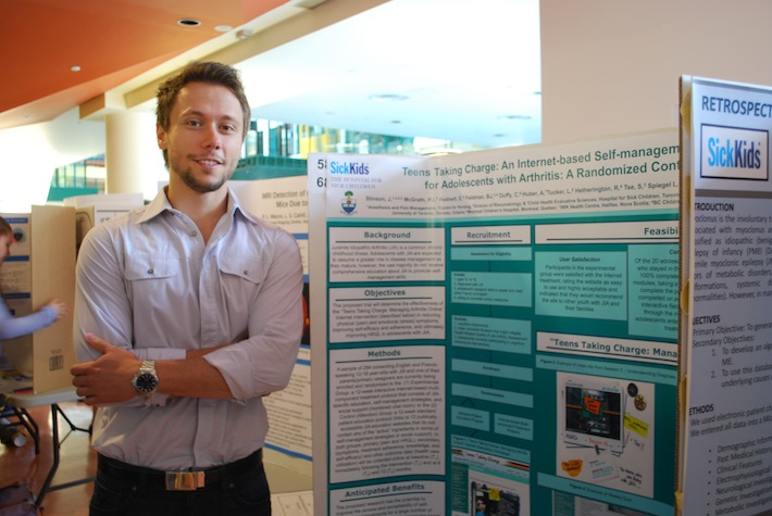 Photo of Josip Marcinko poster presentation at the SickKids Summer Research Program (SSuRE) Symposium, Summer 2012