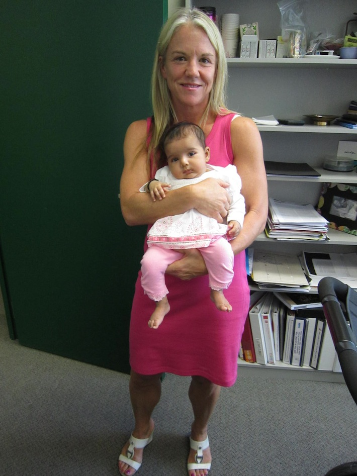 Photo of Dr. Stinson with the first member of the iOUCH lab Jr. Research Team – Baby Reet!