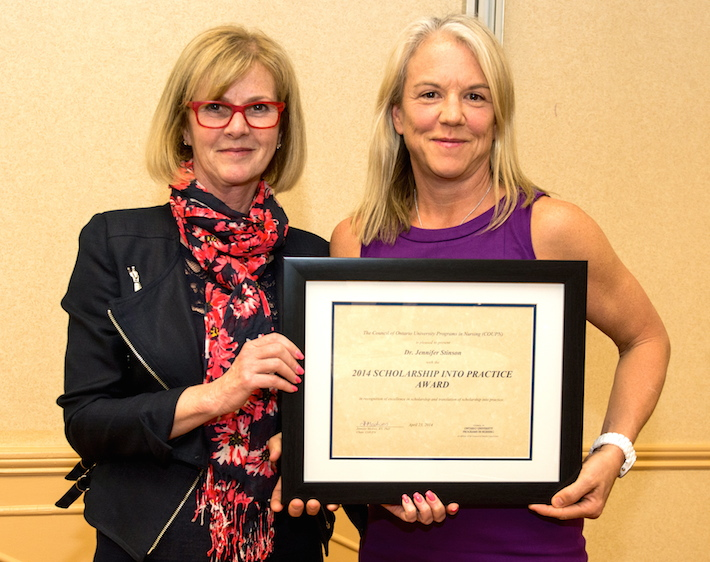 Photo of when Dr. Stinson was awarded the 2014 'Scholarship into Practice' award from the Council of Ontario University Programs in Nursing
