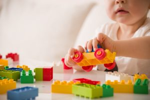 Photo of child playing with lego