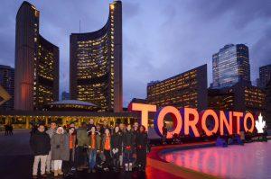Nephrology team with orange-illuminated Toronto sign at Nathan Phillips Square