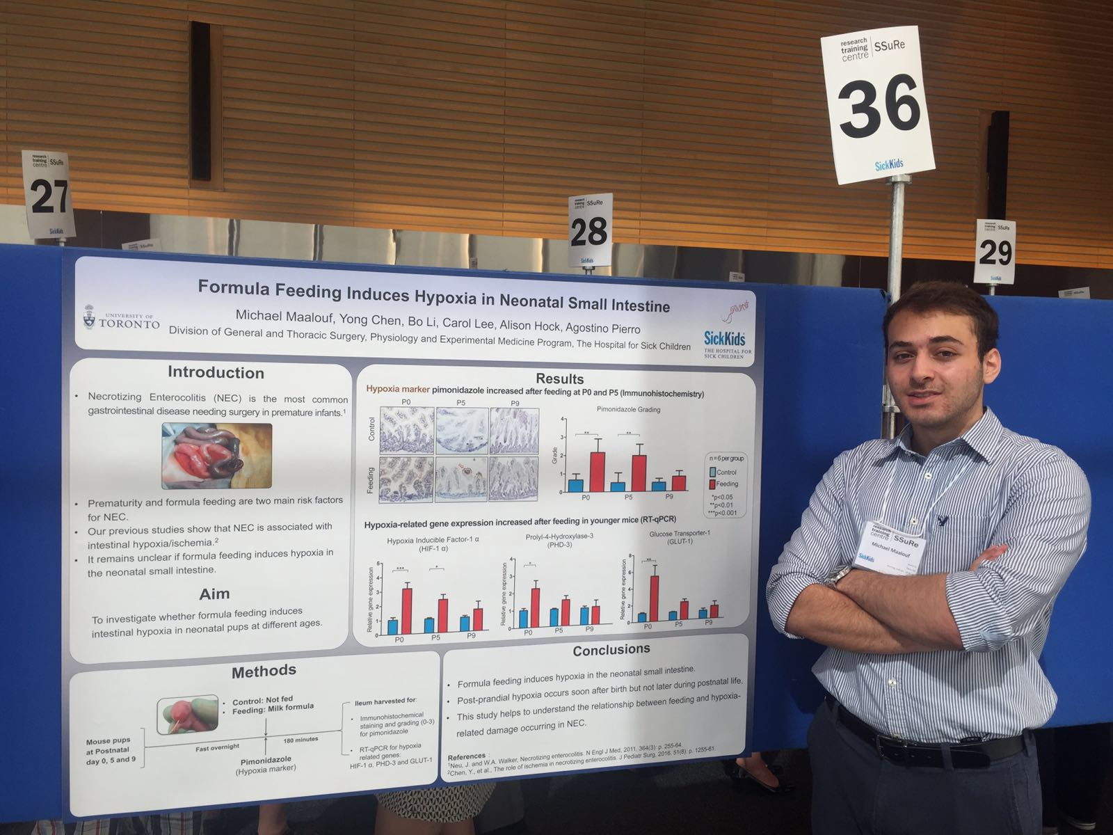 Photo of Michael Maalouf (summer student) presenting his poster at the Annual Summer Student Symposium (August 2016)