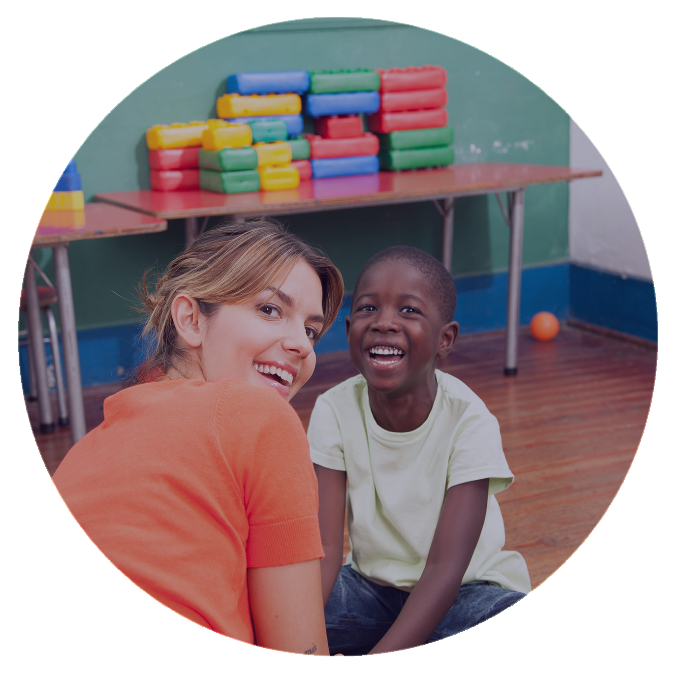 Child and caregiver smiling