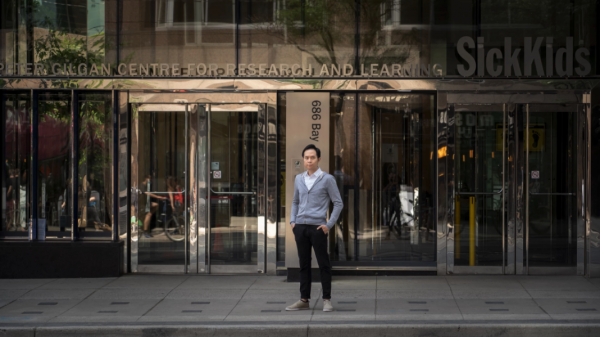 Dr. Yuen standing outside the enterence to the PGCRL